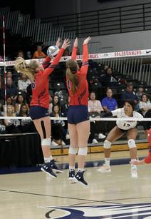 MSU Kyla White (#13) tips ball over CSU blockers Sarah Vang (#6) and Berkley Hays (#17)