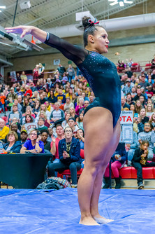 Nikole Addison completes dismount on balance beam and scores 9.800, tied for 6th place.