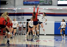 MSU Alyssa Kelling (#8) spikes ball past CSU Berkley Hays (#17)