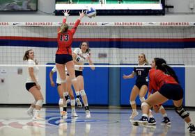 MSU Stephanie Laraway (#6) spikes ball past CSU Mallorie Post (#13)