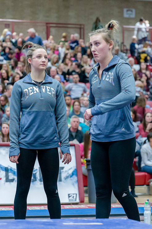 Kaitlyn Schou and Grace Broadhurst during rotation from vault to uneven bars