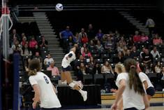 MSU Kyla White (#13) jumps to spike ball