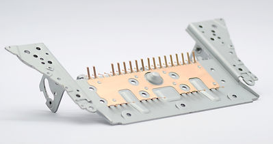 stamped and precision molded parts including deep drawn components