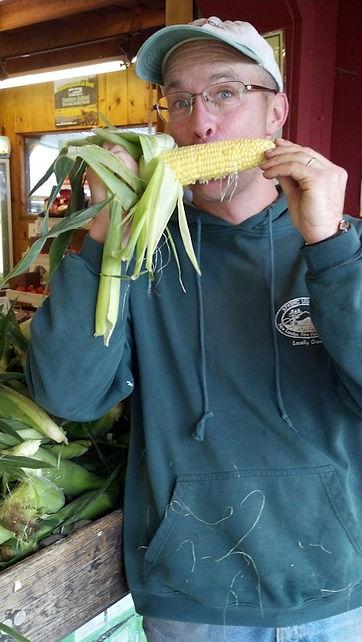 Greg eating Vision corn yellow kernels.j