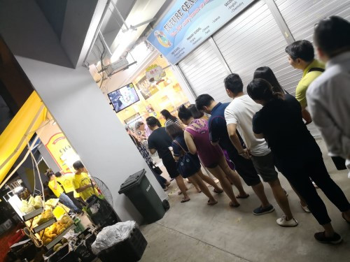 Crowded durian shop in Singapore