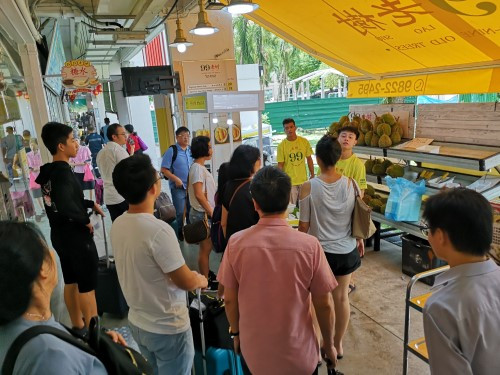 Crowd queuing for durian in Singapore