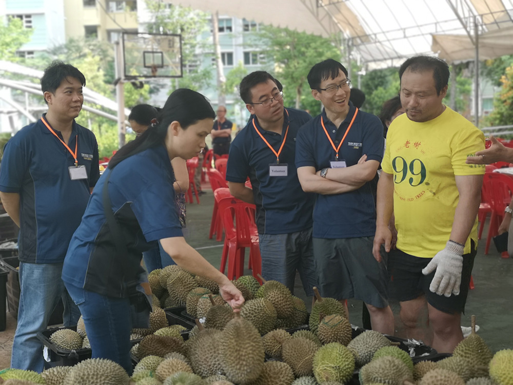 Curious onlookers checking out our durians
