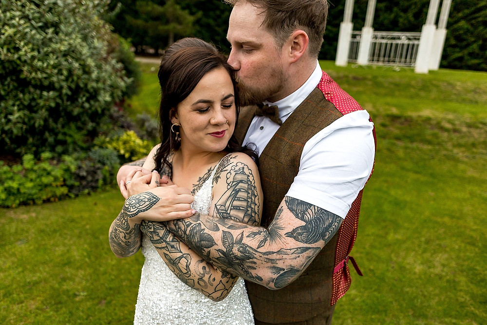 Tattooed bride and groom at Draycote Hotel Wedding