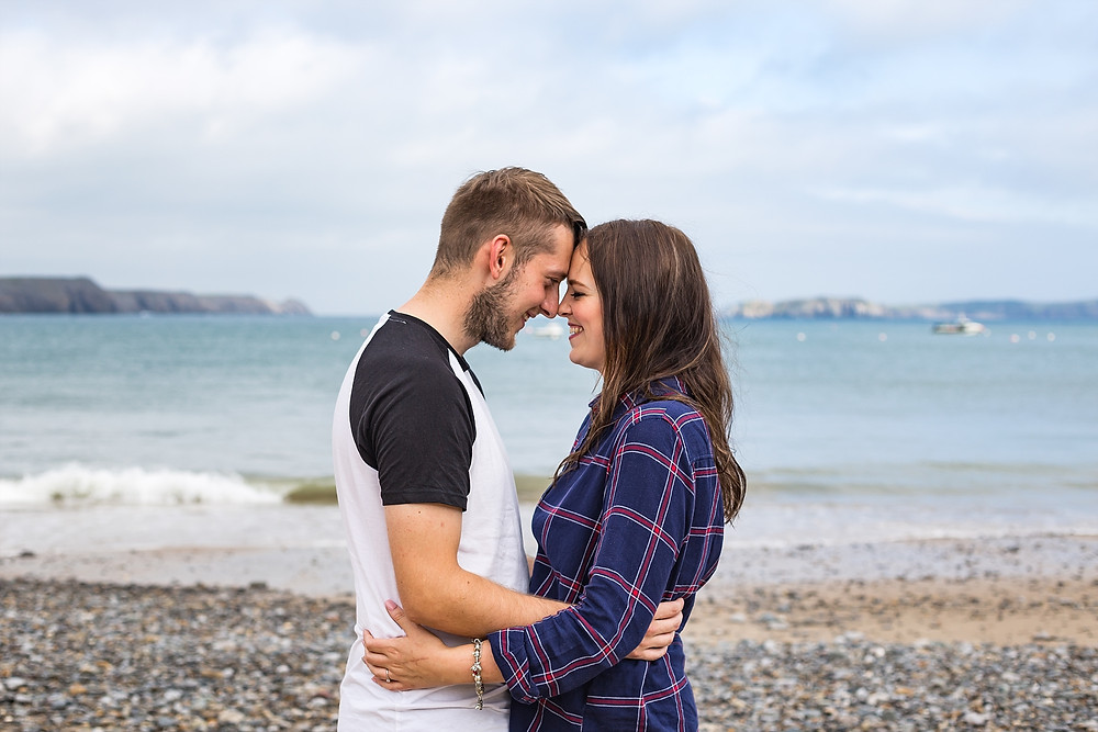 Engaged couple on Lydstep beach, Wales