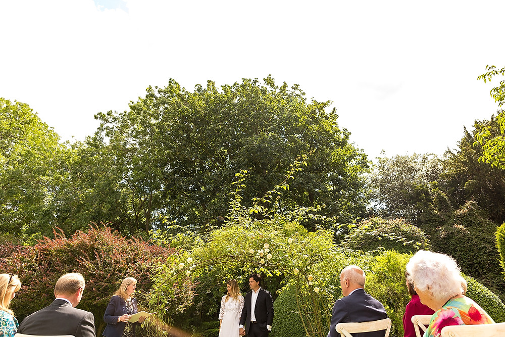 Outdoor garden wedding ceremony in the Cotswolds