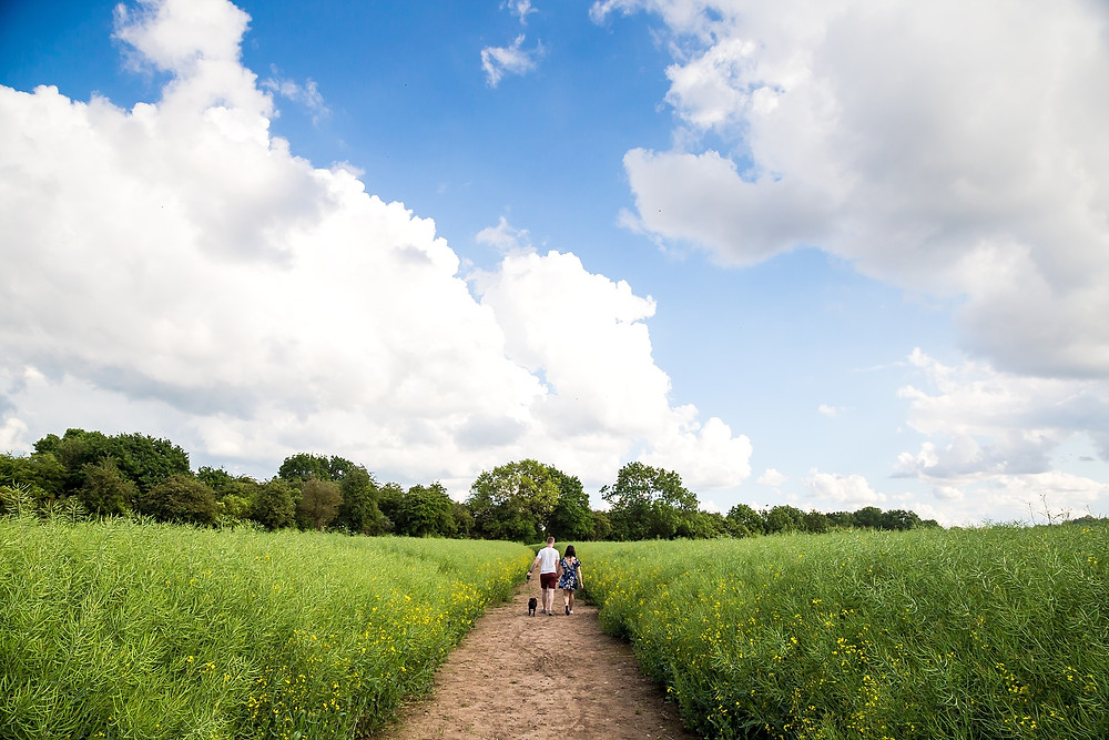 Couple on a dog walk in the Warwickshire countryside