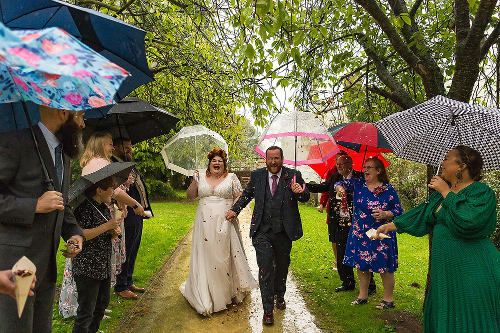 Fun umbrella wedding photo