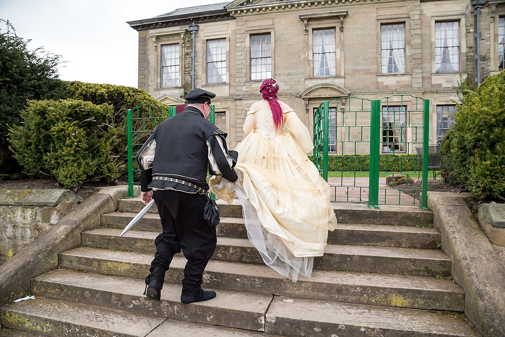 Bride and groom at mediaeval wedding at Coombe Abbey Hotel