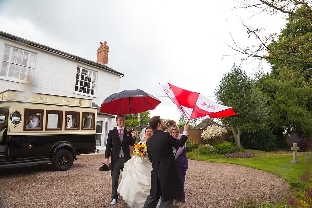Fun umbrella wedding photo