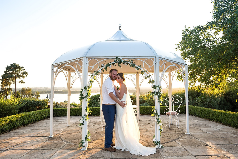 Sunset wedding photos overlooking Rutland Water at Barnsdale Hall Hotel
