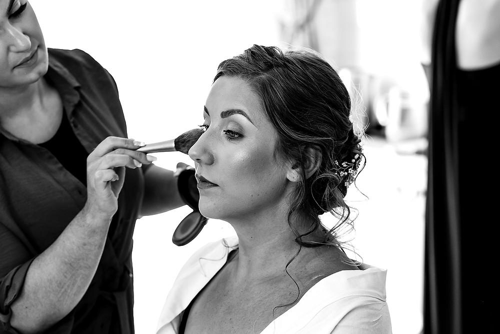 Bride having her make-up done on the morning of her wedding at Wethele Manor