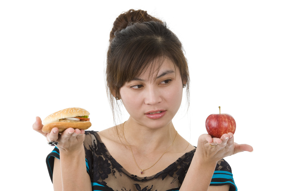 WomanEatingChoices_shutterstock_63476467.jpg