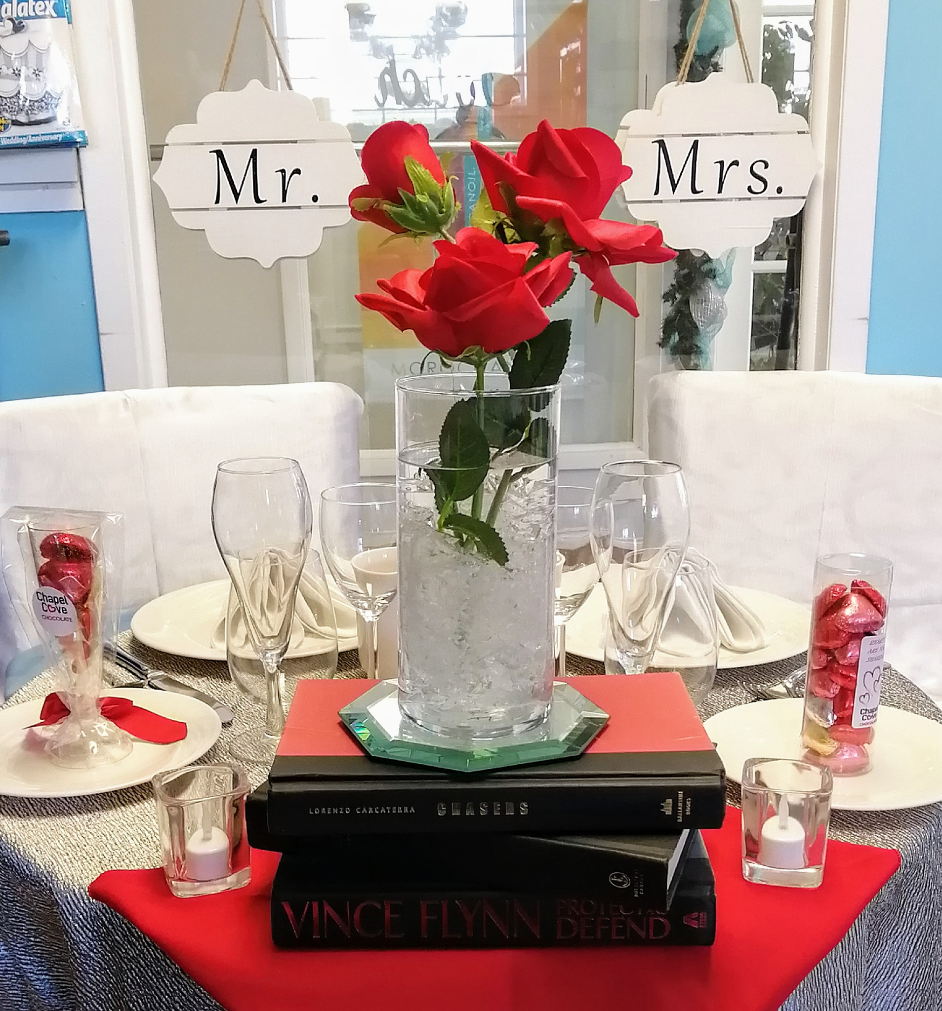 Simple Rose & Stacked Book Centerpiece - Showroom Example