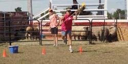 woman's triathlon - skillet throw