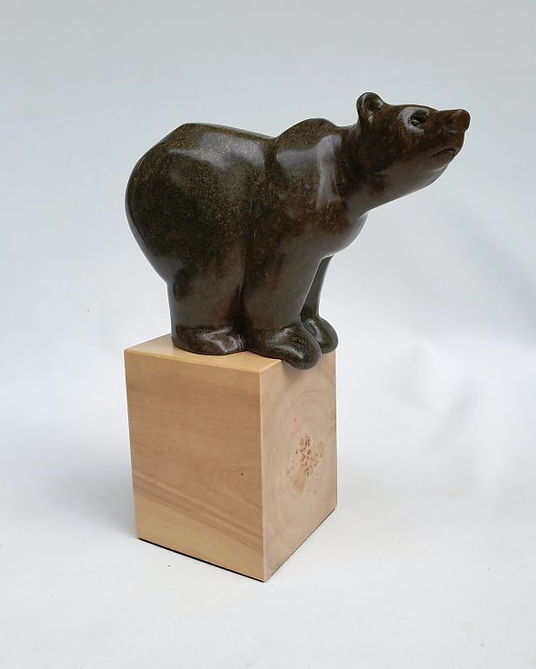 brazilian soapstone scupture titled High Time by sculptor roy hinz.