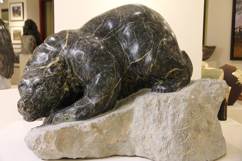 serpentine stone sculpture titled Ready to Pounce by artist fran jenkins.