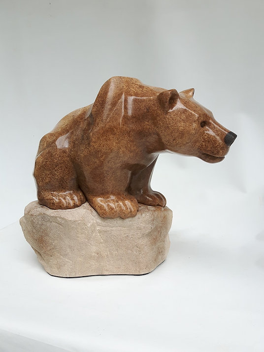 soapstone scupture titled SOLD - Sit a Spell (Poster Bear) by sculptor roy hinz.