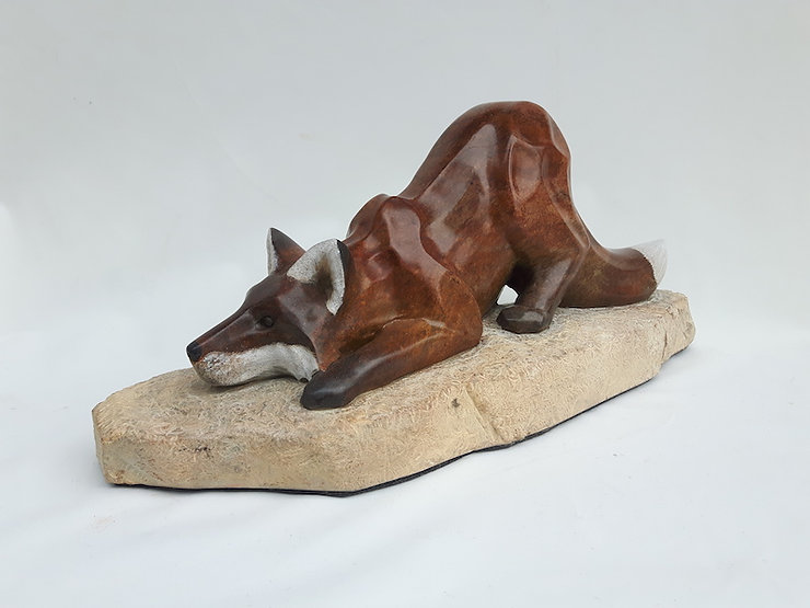 brazilian soapstone scupture titled Your Move (Playful Fox) by sculptor roy hinz.