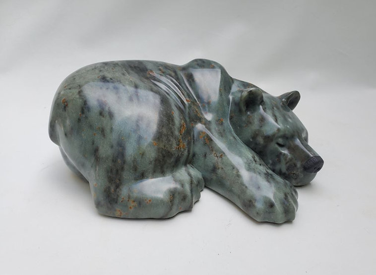 brazilian soapstone scupture titled SOLD-Slowing Down by sculptor roy hinz.