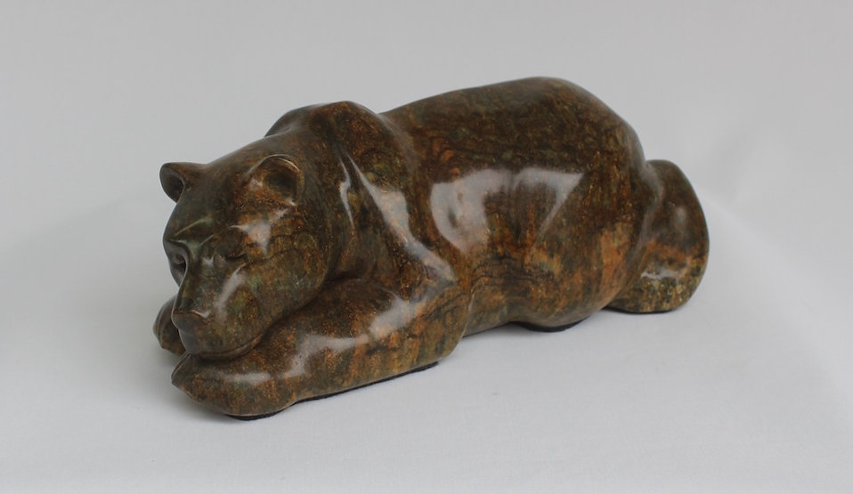 stone carving scupture titled SOLD-Tuckered by sculptor roy hinz.