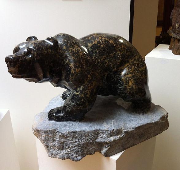 serpentine stone sculpture titled SOLD - 'Walking Bear' by sculptor cathryn jenkins.