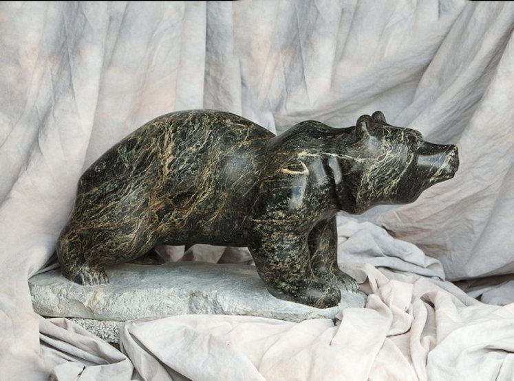 serpentine stone sculpture titled SOLD - Cruising Cub by sculptor cathryn jenkins.