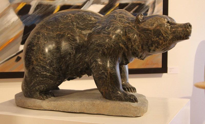 serpentine stone sculpture titled SOLD: 'Alert Bear' by sculptor cathryn jenkins.