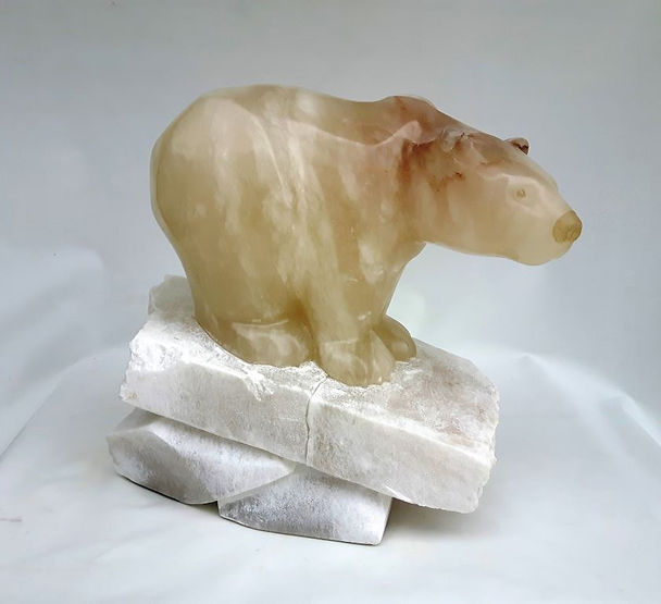 spanish alabaster soapstone scupture titled Slippery Slope by sculptor roy hinz.