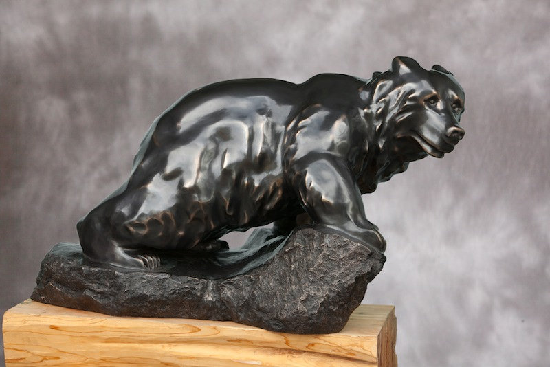 bronze sculpture titled SOLD-On the Move by sculptor cathryn jenkins.