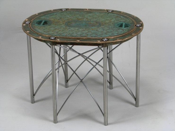 Bronze and chrome table titled SOLD Bronze Hatch Table  by aviation furniture designer arnt arntzen