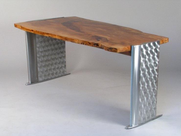 Red and chrome desk titled Heli Desk  by aviation furniture designer arnt arntzen