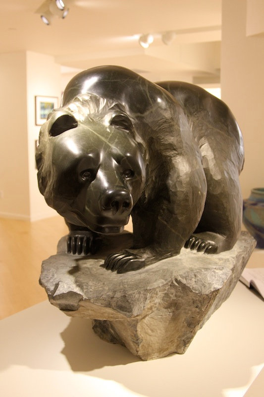 black marble sculpture titled SOLD- Creekside Grizzly by sculptor cathryn jenkins.