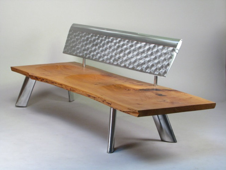 Red and chrome bench titled Jet Ranger Bench by aviation furniture designer arnt arntzen