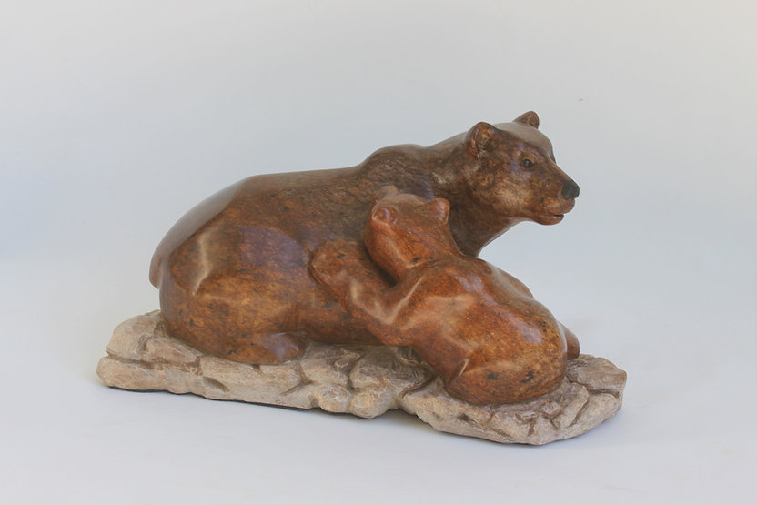 soapstone scupture titled SOLD Bear Hugs by sculptor roy hinz.