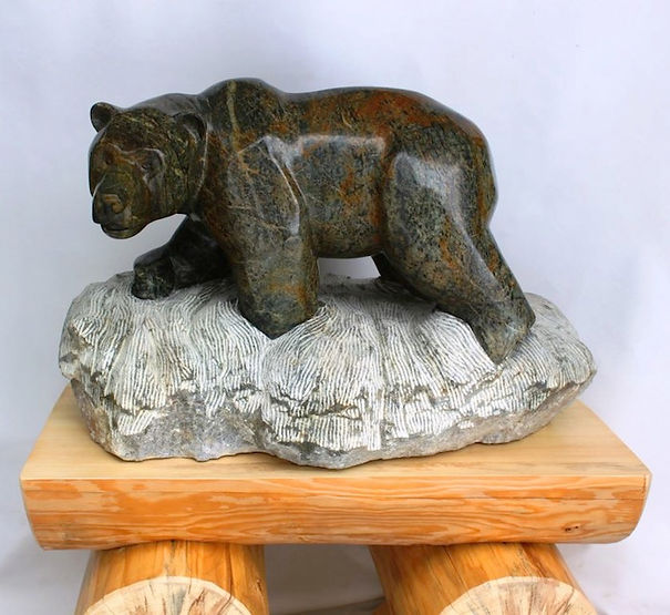 stone carving scupture titled SOLD- Bad Attitude by sculptor roy hinz.