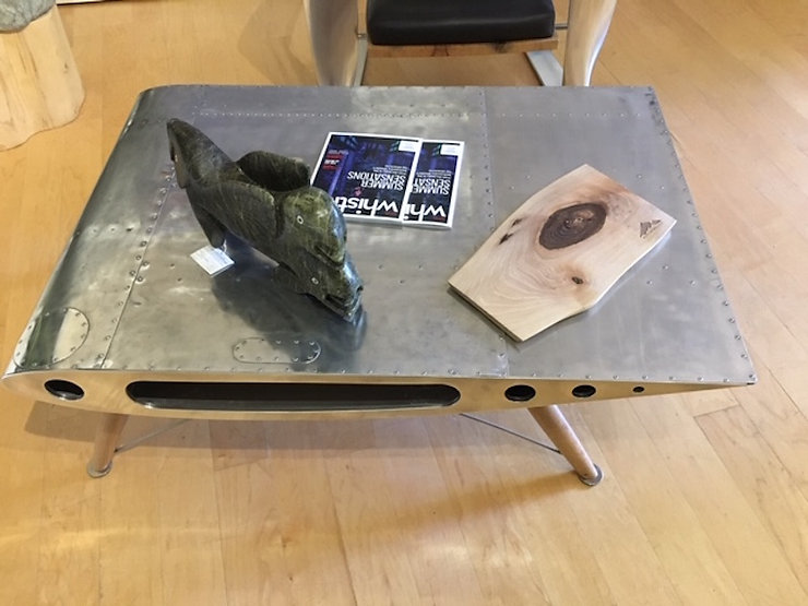 Coffee and chrome table titled Supercub Coffee Table by aviation furniture designer arnt arntzen