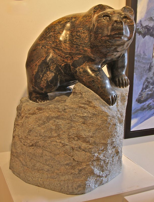 serpentine stone sculpture titled SOLD 'Grizzly Lookout' by sculptor cathryn jenkins.