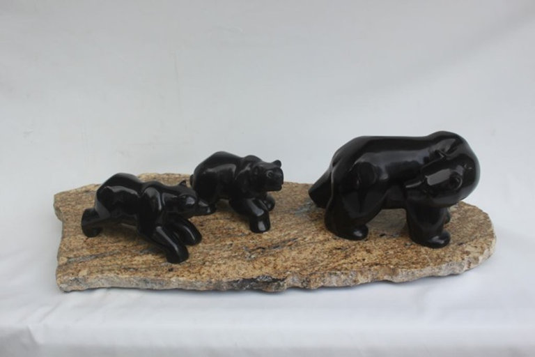 stone carving scupture titled SOLD - Double Trouble by sculptor roy hinz.