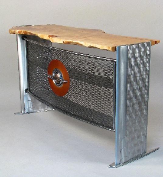 Red and chrome desk titled Global Bar by aviation furniture designer arnt arntzen