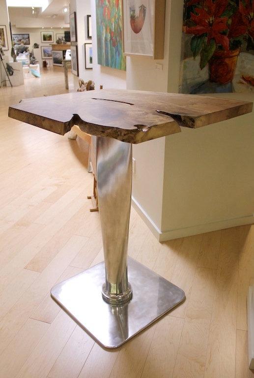 Propeller and chrome table titled Propeller Bar Table by aviation furniture designer arnt arntzen