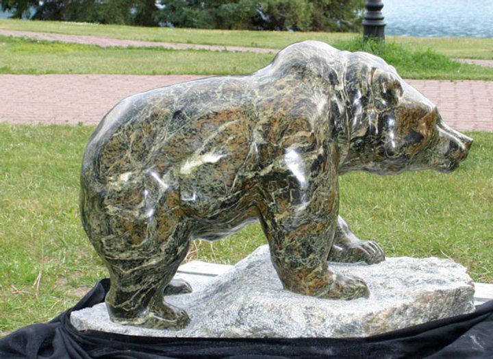 serpentine stone sculpture titled Medium Walking Bear- Green by artist fran jenkins.
