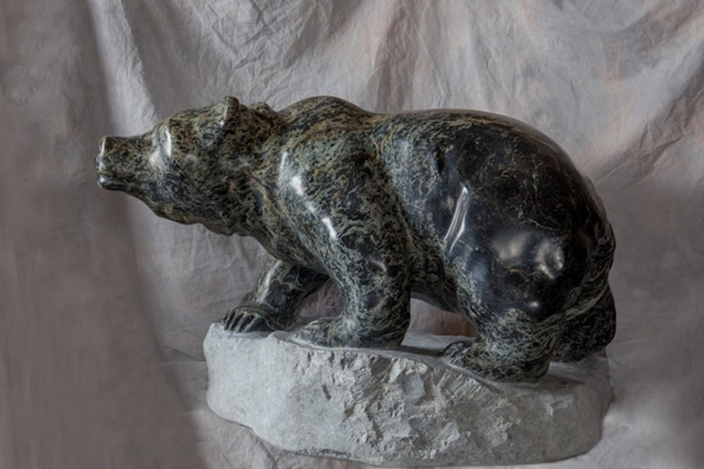 serpentine stone sculpture titled SOLD - Green Grizz by sculptor cathryn jenkins.