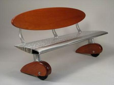 Red and chrome bench titled Heli bench by aviation furniture designer arnt arntzen