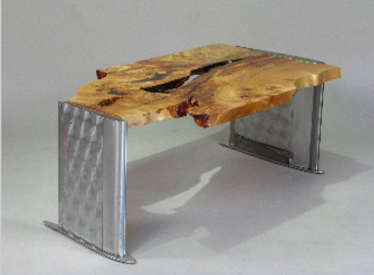 Red and chrome table titled Chinook Heli Coffee Table by aviation furniture designer arnt arntzen