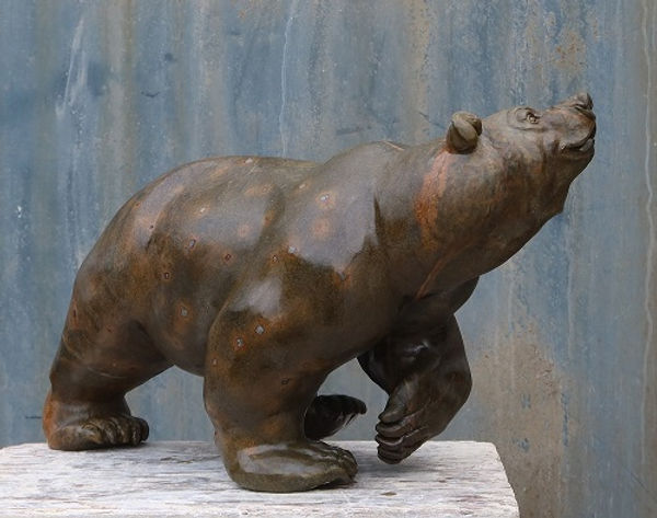 brazilian soapstone sculptor titled Happy Go Lucky by sculptor andrew gable.